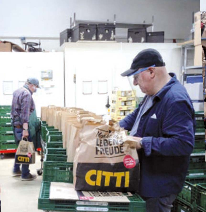 Mann im Lebensmittel Depot der Tafel Kiel